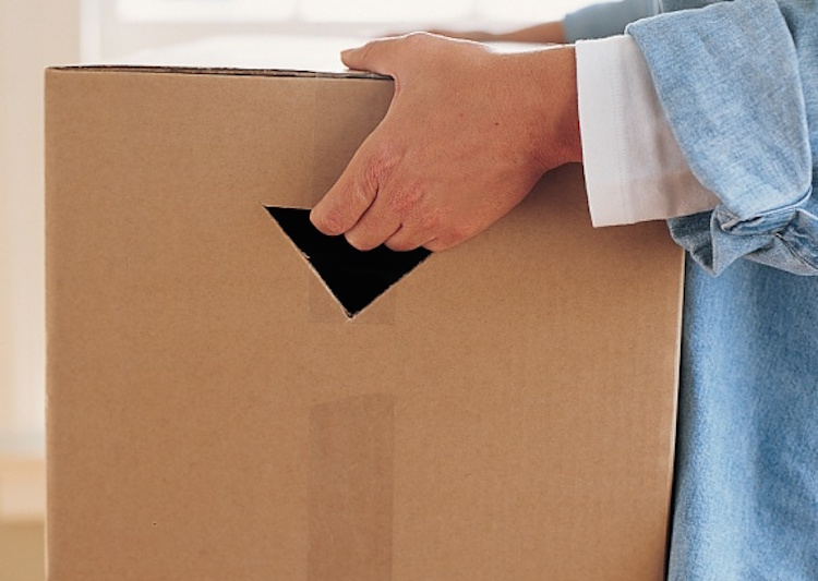 cut handles into cardboard boxes make moving easier moving to dallas life hacks kyvno